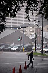 12 June  2015. New Orleans, Louisiana. <br /> heavy rain falls Downtown.<br /> Photo©; Charlie Varley/varleypix.com