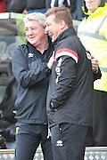 Hull City manager Steve Bruce(left) and Milton Keynes Dons Manager Karl Robinson during the Sky Bet Championship match between Hull City and Milton Keynes Dons at the KC Stadium, Kingston upon Hull, England on 12 March 2016. Photo by Ian Lyall.