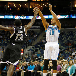 Jan 21, 2013; New Orleans, LA, USA; New Orleans Hornets shooting guard Eric Gordon (10) shoots over Sacramento Kings point guard Tyreke Evans (13) during the first quarter of a game at the New Orleans Arena. Mandatory Credit: Derick E. Hingle-USA TODAY Sports