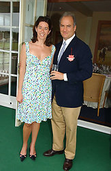 FLORENCE PAUL and CHARLES FINCH at the Queen's Cup polo final sponsored by Cartier at Guards Polo Club, Smith's Lawn, Windsor Great Park on 18th June 2006.  The Final was between Dubai and the Broncos polo teams with Dubai winning.<br /><br />NON EXCLUSIVE - WORLD RIGHTS