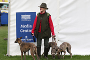 Visitor and her dogs enjoying the fine weather during the International Horse Trials at Chatsworth, Bakewell, United Kingdom on 11 May 2018. Picture by George Franks.