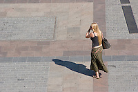Woman walking on the Rynkek in Krakow Poland