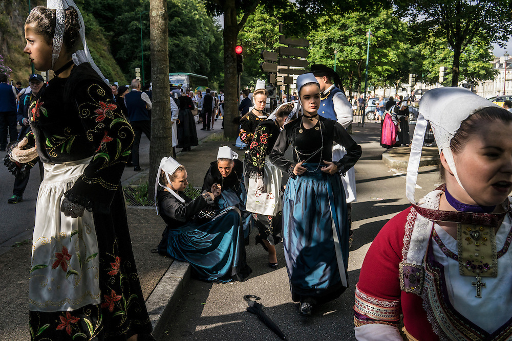 Participants prepare for the Great Parade at the Festival de Cornouaille on Sunday, July 24, 2016 in Quimper, France.