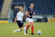 Caroline Weir (#9) of Scotland passes the ball beyond the challenge of Yulia Slesarchik (#11) of Belarus during the FIFA Women's World Cup UEFA Qualifier match between Scotland Women and Belarus Women at Falkirk Stadium, Falkirk, Scotland on 7 June 2018. Picture by Craig Doyle.