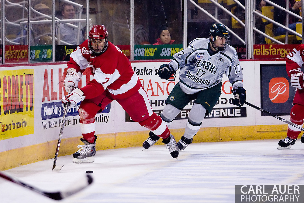 October 13, 2007 - Anchorage, Alaska:  Brian Strait (7) of the Boston University Terriers protects the puck during game 4 of the Nye Frontier Classic at the Sullivan Arena.  UAA and BU would tie 4-4 giving Robert Morris University the title of Nye Frontier Classic Champion.