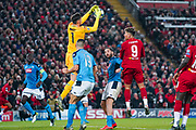 Napoli goalkeeper Alex Meret (1) and Liverpool forward Roberto Firmino (9) in action during the Champions League match between Liverpool and Napoli at Anfield, Liverpool, England on 27 November 2019.