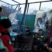 KIEV, UKRAINE - February 23, 2014: Members of Maidan's defence unit take guard at one of the many checkpoints outside Kiev's Independence Square. CREDIT: Paulo Nunes dos Santos