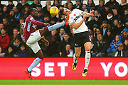 Derby County defender Craig Forsyth (3) is caught by Aston Villa defender Axel Tuanzebe (4) during the EFL Sky Bet Championship match between Derby County and Aston Villa at the Pride Park, Derby, England on 10 November 2018.