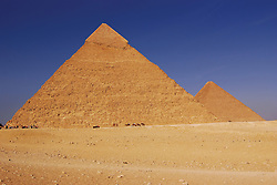 Pyramids of Giza in Egypt against a blue sky