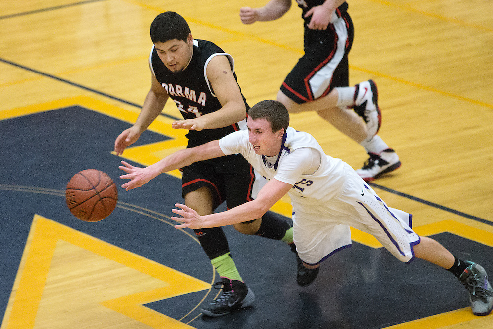 GABE GREEN/Press<br /> <br /> Gus Colburns falls as he attempts to pass Thursday during Kellogg&rsquo;s game against Parma in the 2014 Real Dairy Shootout.