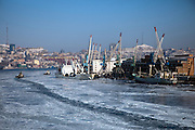 The ice covered port of Vladivostok in Russia, Sea of Japan (East Sea). Vladivostok, Russian Federation, Russia, RUS, 12.01.2010.