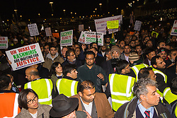 Amid high security measures, hundreds of Kashmiri protesters, supported by George Galloway, demonstrate outside Wembley Stadium ahead of an address to more than 60,000 Indian expats by Prime Minister Narendra Modi at a 'UK Welcomes Modi' reception. Modi, a Hindu and his BJP party are accused of a wide range of human rights abuses against religious and ethnic minorities in India. PICTURED: Kashmiris protest outside the Stadium as Modi addresses the crowd inside.