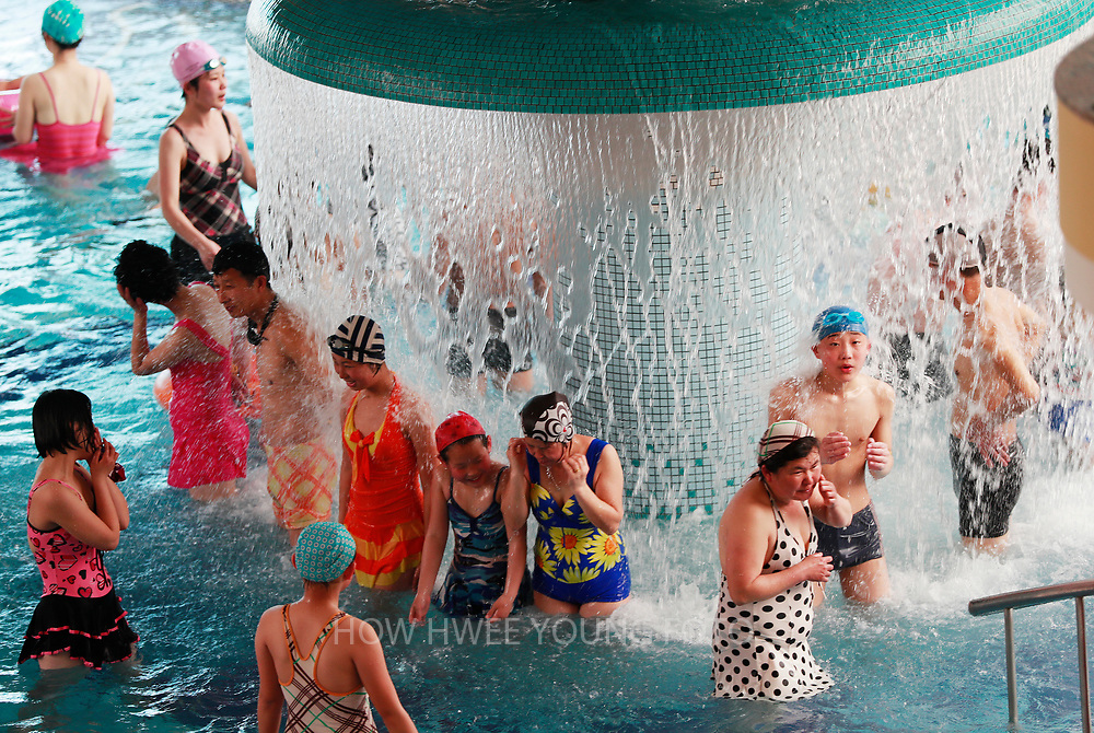 North Koreans enjoy a water fall feature in the Munsu Water Park on a national holiday as part of celebrations of the 'Day of the Sun', commemorating the 105th birth anniversary of late supreme leader Kim Il-sung in Pyongyang, North Korea, 16 April 2017. A North Korean missile exploded within seconds of its launch on the east coast on 16 April, South Korean and US officials say as tensions rise in the region over nuclear issues.