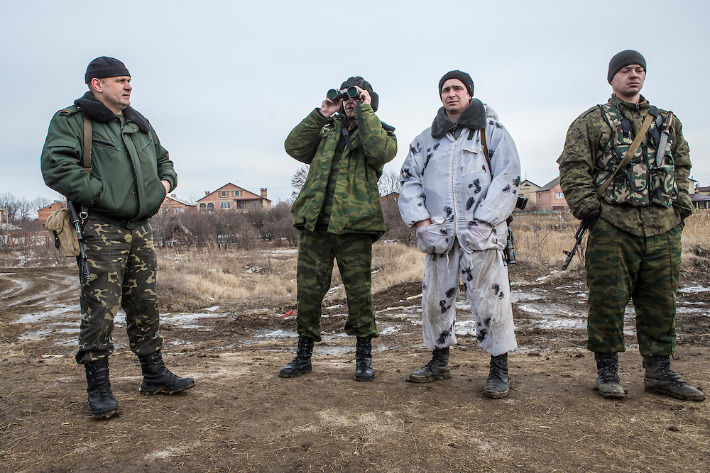 GORLOVKA, UKRAINE - JANUARY 31, 2015: Rebel fighters watch along a front-line position in Gorlovka, Ukraine. Fighting in Ukraine has intensified over the last week, with rebels declaring the end of a September ceasefire. CREDIT: Brendan Hoffman for The New York Times