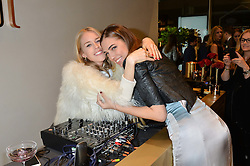 Left to right, LADY MARY CHARTERIS and AMBER LE BON at a party to celebrate the launch of the Monica Vinader London Flagship store at 71-72 Duke of York Square, London SW3 on 4th December 2014.