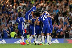 Cesar Azpilicueta of Chelsea jumps up as Eden Hazard of Chelsea celebrates scoring a goal from the penalty spot to make it 1-0 - Rogan Thomson/JMP - 15/08/2016 - FOOTBALL - Stamford Bridge Stadium - London, England - Chelsea v West Ham United - Premier League Opening Weekend.
