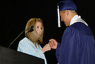 2012 class president Kayla Hill (left) and 2011 class president David Choi during the Fairborn High School commencement at the Nutter Center in Fairborn, Friday, May 27, 2010.
