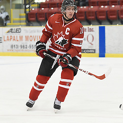 WELLINGTON, - Dec 11, 2015 -  Exhibition Game 2- Team USA vs Team Canada East at the 2015 World Junior A Challenge at the Wellington District Community Centre, ON. Grant Cooper #10 of Team Canada East follows the play during the second period.<br /> (Photo: Andy Corneau / OJHL Images)
