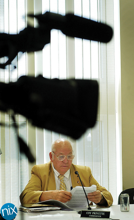 All cameras were on Coy Privette as he sat quietly and made no comment during the Cabarrus County Commission's work session Tuesday afternoon. Privette, who has pleaded guilty to six counts of of aiding and abeting prostitution, has refused to resign his commission seat.