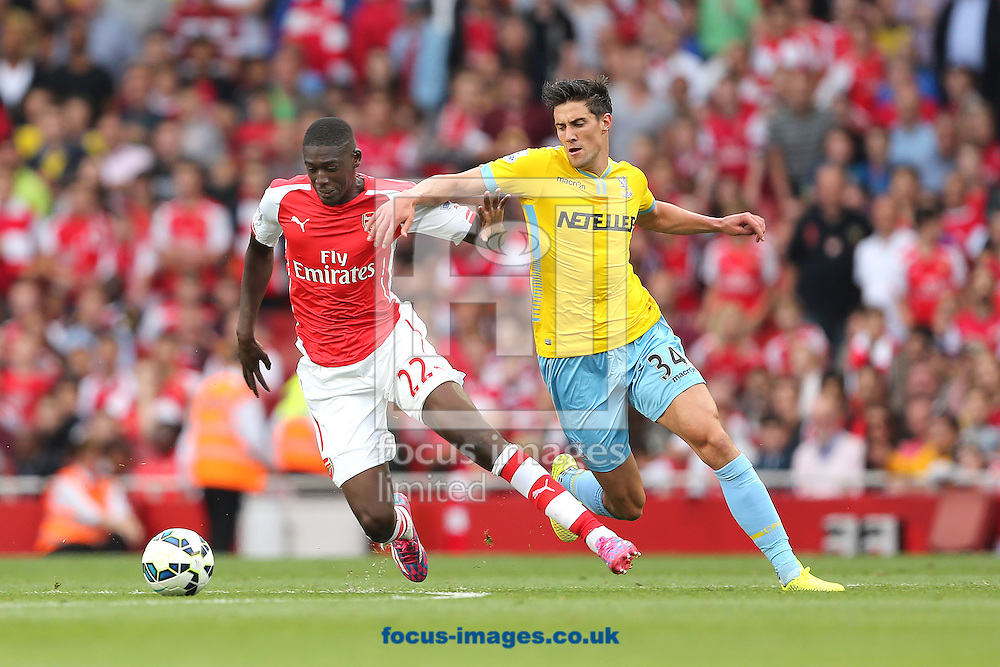 Yaya Sanogo of Arsenal and Martin Kelly of Crystal Palace during the Barclays Premier League match at the Emirates Stadium, London<br /> Picture by Richard Calver/Focus Images Ltd +447792 981244<br /> 16/08/2014