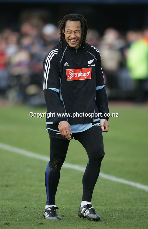 All Black captain Tana Umaga is all smiles during a training session held at QE II Park, Christchurch, New Zealand, on Monday 20 June, 2005. Photo: PHOTOSPORT<br />