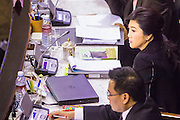 "09 JANUARY 2105 - BANGKOK, THAILAND:  YINGLUCK SHINAWATRA, former Prime Minister of Thailand, listens to the government case against her during her impeachment trial in the National Legislative Assembly. Thailand's military-appointed National Legislative Assembly began impeachment hearings Friday against former Prime Minister Yingluck Shinawatra. If she is convicted, she could be forced to stay out of politics for five years. During her defense, Yingluck questioned the necessity of her impeachment, saying, ""I was removed from office, the equivalent of being impeached, three times already, I have no position left to be impeached from."" A decision on her impeachment is expected by the end of January.   PHOTO BY JACK KURTZ"