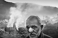 Hadyatullah in front of his tent on the outskirts of Balakot. He and his wife lost two sons and two daughters when the earthquake crushed the children's school. <br /> Balakot - Nov. 2005