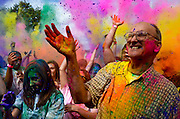 Kaitlyn Jones (left) and Gaura Shakti (right) of Moundsville, W. Va. throw colored powders into the air to celebrate the New Vrindaban Festival of Colors, Sept. 15, 2012, at the Palace of Gold, Moundsville, W.Va. Mr. Shakti is an original founder of the Palace of Gold, a temple of the International Society for Krishna Consciousness, having helped build it from 1972-1979. This event was the first official colors festival the palace has held in Moundsville. These events are expected to grow in popularity through word of mouth on college campuses in the area.