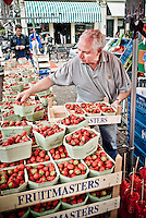 Vendor selling strawberries at Noordermarkt, Amsterdam.