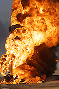 Burning oil well at Rumaila Oil Field in southern Iraq. The wells were ignited by retreating Iraqi troops when the US and UK invasion began. Seven or eight wells were set ablaze and at least one other was detonated but did not ignite. The Rumaila field is one of Iraq's biggest oil fields with five billion barrels in reserve. Many of the wells are 10,000 feet deep and produce huge volumes of oil and gas under tremendous pressure, which makes capping them very difficult and dangerous. Rumaila is also spelled Rumeilah.
