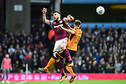 Aston Villa midfielder (on loan from West Ham United) Robert Snodgrass (7) heads the ball  under pressure from Wolverhampton Wanderers defender Barry Douglas (3) during the EFL Sky Bet Championship match between Aston Villa and Wolverhampton Wanderers at Villa Park, Birmingham, England on 10 March 2018. Picture by Dennis Goodwin.