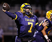 Milpitas High School quarterback Ronnie Reed (7) throws the ball to an open receiver against Woodside at Milpitas High School in Milpitas, California, on September 13, 2013. The Trojans went on to beat the Wildcats 50-6. (Stan Olszewski/SOSKIphoto)