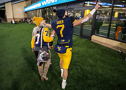 Oct 25, 2018; Morgantown, WV, USA; West Virginia Mountaineers quarterback Will Grier (7) celebrates with his wife after beating the Baylor Bears at Mountaineer Field at Milan Puskar Stadium. Mandatory Credit: Ben Queen-USA TODAY Sports