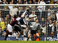Photo: Chris Ratcliffe.<br />Tottenham Hotspur v Arsenal. The Barclays Premiership.<br />29/10/2005.<br />Ledley King climbs high above Sol Campbell to head Spurs in front
