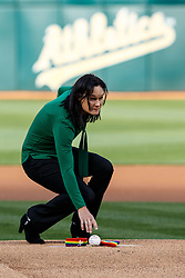 OAKLAND, CA - JUNE 14:  University of San Francisco Women's basketball coach Jennifer Azzi places a baseball on the pitchers mound in remembrance of victims of the Orlando terror attack on Pride Night before the game between the Oakland Athletics and the Texas Rangers at the Oakland Coliseum on June 14, 2016 in Oakland, California. (Photo by Jason O. Watson/Getty Images) *** Local Caption *** Jennifer Azzi