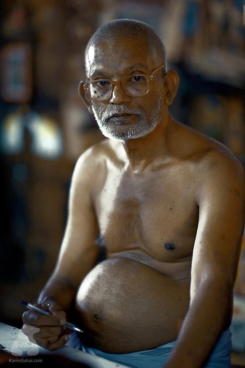 Man with a pot belly, Madurai, Tamil Nadu, India.