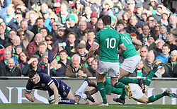 Scotland's Blair Kinghorn scores his side's first try during the NatWest Six Nations match at the Aviva Stadium, Dublin.