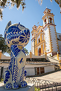 Parroquia Santa María Magdalena church with a giant Talavera pottery animal in Xico, Veracruz, Mexico.