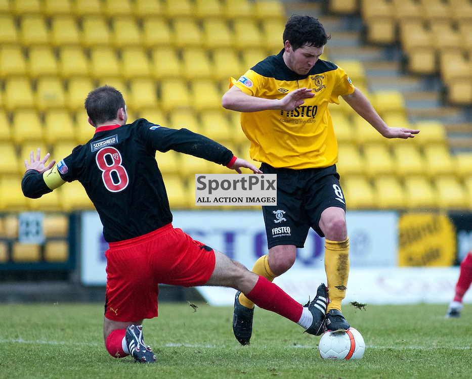 David Rowson and Liam Fox battle for the ball, Livingston v Partick Thistle, SFL Division 1, Braidwood Motor Company Stadium,