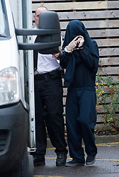 © London News Pictures. 16/12/2013 . Oxford, UK. BEN BLAKELEY, showing a V sign to photographers as he  is led to a prison van in handcuffs after appearing at Oxford Magistrates Court, charged with the murder of missing teenager Jayden Parkinson.  Photo credit : Ben Cawthra/LNP