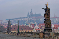 View of Charles Bridge in Prague (Karlúv Most) the Czech Republic. early morning with mist. This bridge is the oldest in the city and a very popular tourist attraction.