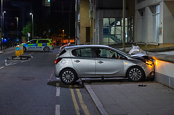 © Licensed to London News Pictures. 13/05/2020. London, UK. A vehicle that has  collided with a wall on Lombard Street where police found two men injured. Police were called at around 1800BST on Wednesday, 13 May, to reports of a man with a knife in Lombard Road, SW11. There were also reports of a car in collision with a wall in Lombard Road. Officers attended the location and found two men injured - one had cuts to his arms and the other cuts to his legs. Officers believed the two men had been travelling in the car. Both have been taken to hospital, where their injuries are not believed to be life-threatening. Investigations at the scene led officers to Vicarage Crescent, SW11, where they found two other injured men. Both were taken to hospital with non life-threatening injuries. Photo credit: Peter Manning/LNP