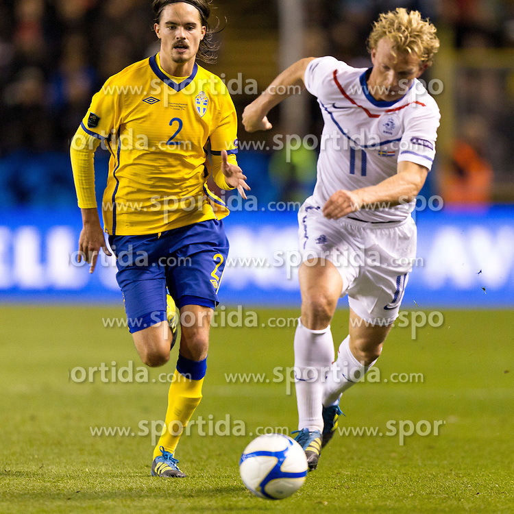 11.10.2011, Rasundastadion, Solna, SWE, UEFA EURO 2012, EMQ, Schweden vs Niederlande, im Bild .Netherlands 11 Dirk Kuyt ahead of Sweden 2 Mikael Lustig // during EM Qualifikations Football match between Sweden an Netherlands at Rasundastadion in Solna, Sweden on 11/10/2011. EXPA Pictures © 2011, PhotoCredit: EXPA/ PICAGENCY Skycam/ Sami Grahn +++++ ATTENTION - OUT OF SWEDEN/SWE+++++