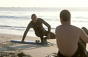 A surfer, body boarder, laughing with his friend, Quenver beach, Cornwall, UK 2004