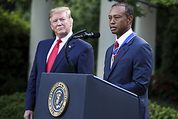 President Donald Trump looks as Tiger Woods speaks after he received the Presidential Medal of Freedom during a ceremony in the Rose Garden of the White House on May 6, 2019 in Washington, DC. (Photo by Oliver Contreras/SIPA USA)