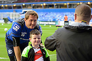 Tomasz Kuszczak posses with a fan during the Sky Bet Championship match between Birmingham City and Derby County at St Andrews, Birmingham, England on 21 August 2015. Photo by Alan Franklin.