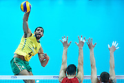 Brazil's Wallace De Souza (left) spikes the ball while volleyball match between Brazil and Russia during the 2014 FIVB Volleyball World Championships at Spodek Hall in Katowice on September 14, 2014.<br /> <br /> Poland, Katowice, September 14, 2014<br /> <br /> For editorial use only. Any commercial or promotional use requires permission.<br /> <br /> Mandatory credit:<br /> Photo by &copy; Adam Nurkiewicz / Mediasport