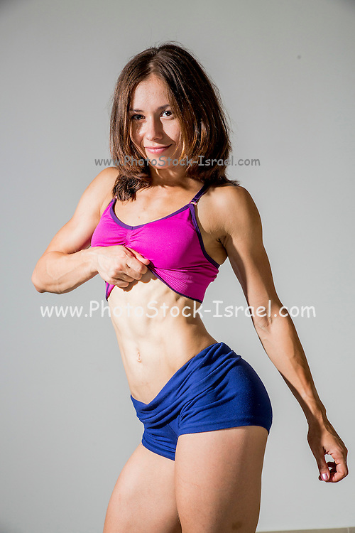 Fitness, sport, training women in sport clothing in studio on gray background Model Release available