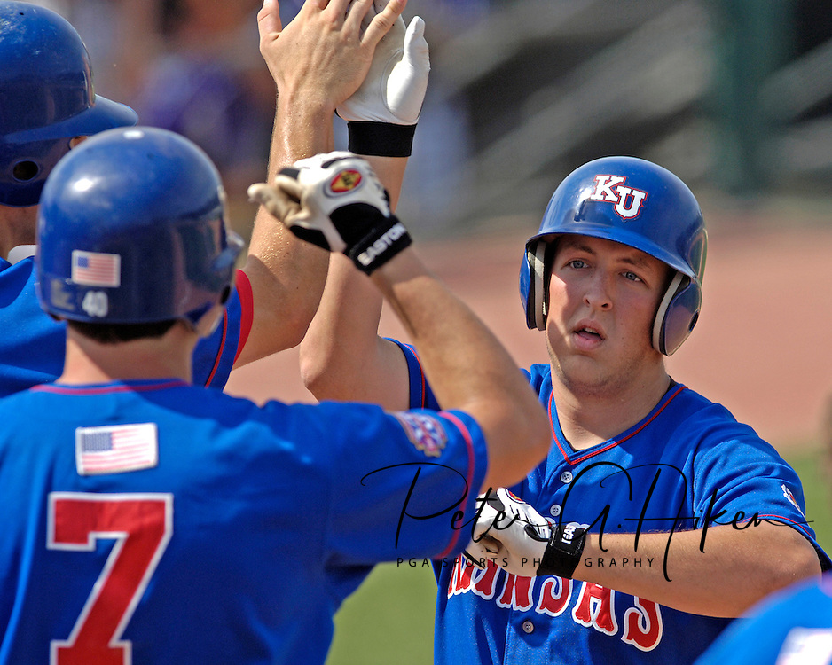 Kansas pinch hitter Justin Ellrich (R) celebrates with his teammates, after hitting a two run homer, to draw the Jayhawks within one run in the top of the eighth inning.  The Wildcats held on to beat Kansas 5-4 at Tointon Stadium in Manhattan, Kansas, April 23, 2006.