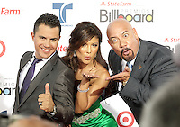 (CH) fl-el-billboard-latin-music-awards-CH7 --(L-R) Karim Mendiburu, Mirella Grisales, and Edgar Lopez arrive at the Billboard Latin Music Awards 2012 at Bank United Center on April 26, 2012 in Miami, Florida Staff photo/Cristobal Herrera